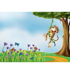 A monkey hanging on a vine plant vector image