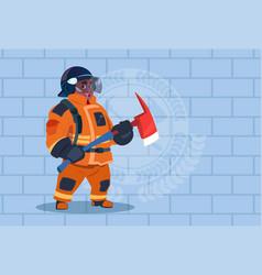 African american fireman holding hammer wearing vector