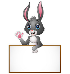 cartoon bunny waving hand with holding blank sign vector image