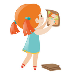 Girl putting picture up on the wall vector