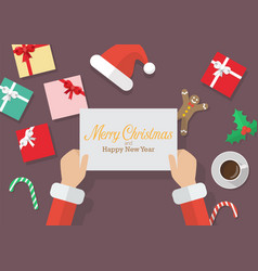 santa claus hands holding a merry christmas and vector image