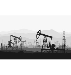 Oil pumps at large oilfield over mountain range vector image vector image
