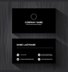 black paper business namecard on a black wood vector image vector image