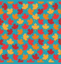 Autumn maple leaves seamless pattern on blue vector