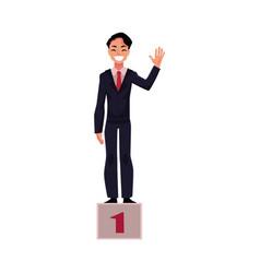 Happy businessman standing on pedestal number one vector