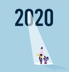 Businessman standing under 2020 vector