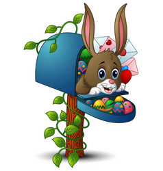 Easter bunny with easter eggs and the mailbox vector