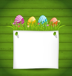 Easter colorful eggs in green grass with empty vector image