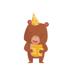 adorable brown bear holding preset in paws vector image