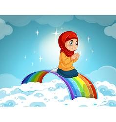 Muslim girl praying over the rainbow vector