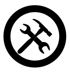 wrench and hammer icon black color in circle vector image