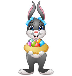 easter bunny holding easter eggs in nest vector image