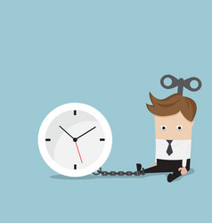Businessman gets chained with clock vector