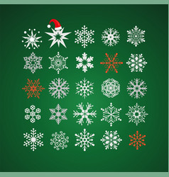 white and red snowflakes on dark green background vector image