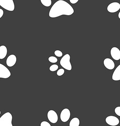 Paw icon sign Seamless pattern on a gray vector
