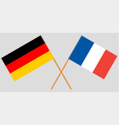 The crossed germany and france flags vector