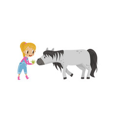 cute litlle girl feeding horse with green grass vector image