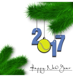 Tennis ball and 2017 on a Christmas tree branch vector image