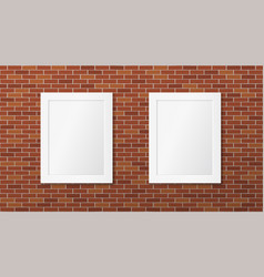 two white frames on a brick wall pictures layout vector image