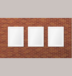 three white frames on a brick wall vector image