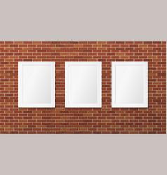 Three white frames on a brick wall vector