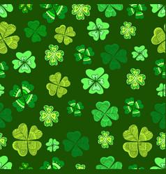 seamless green clover leaf decorative on a dark vector image