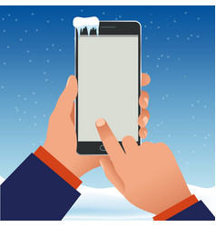 female hand is holding a phone outside in the vector image