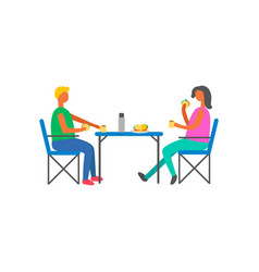 happy couple on picnic sitting on chairs at table vector image