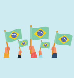 Cheering group with brazilian national flags vector