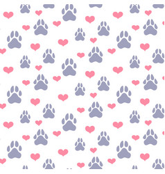 Paw prints and hearts pattern vector