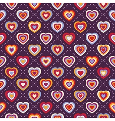 Seamless background with multicolored hearts vector image