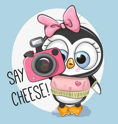 cute cartoon penguin with a camera vector image