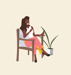 Happy woman sitting on armchair african american vector
