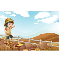 A young female explorer walking alone vector