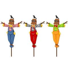 Three scarecrows on wooden sticks vector