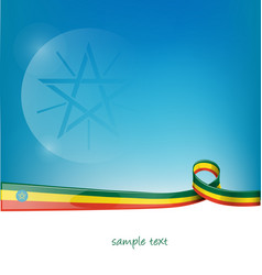 ethiopia ribbon flag on blue sky background vector image