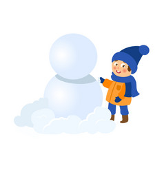 boy having fun making snowman isolated vector image