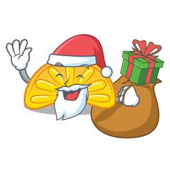 Santa with gift orange jelly candy mascot cartoon vector