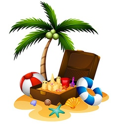 Summer theme with suitcase and sandcastle vector image