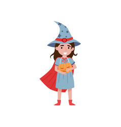 cute little girl dressed as a witch holding basket vector image