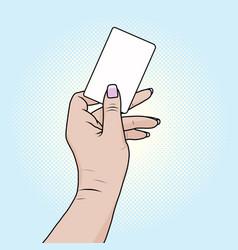 Card or bank card in a female hand pop art retro vector
