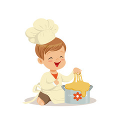 Cute smiling little boy chef kneading a dough vector