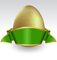 gold easter egg tied with green ribbon vector image vector image