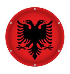 Round metallic flag of albania with screws vector