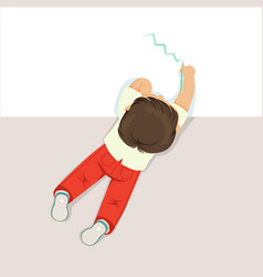 little boy lying on his stomach and drawing using vector image