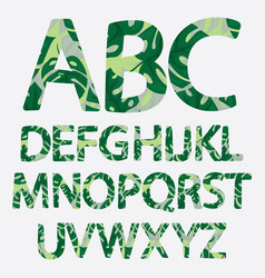 tropical alphabet made of banana palm leaves vector image