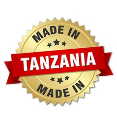made in Tanzania gold badge with red ribbon vector image vector image