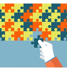 Businessman assembling jigsaw puzzle vector image