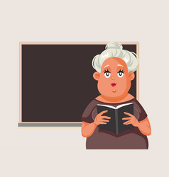 female teacher holding a book in classroom vector image