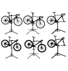 Bicycles in repair stand vector